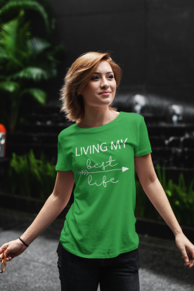 t-shirt-mockup-of-a-young-woman-standing-against-a-dark-background-with-some-plants-411-el