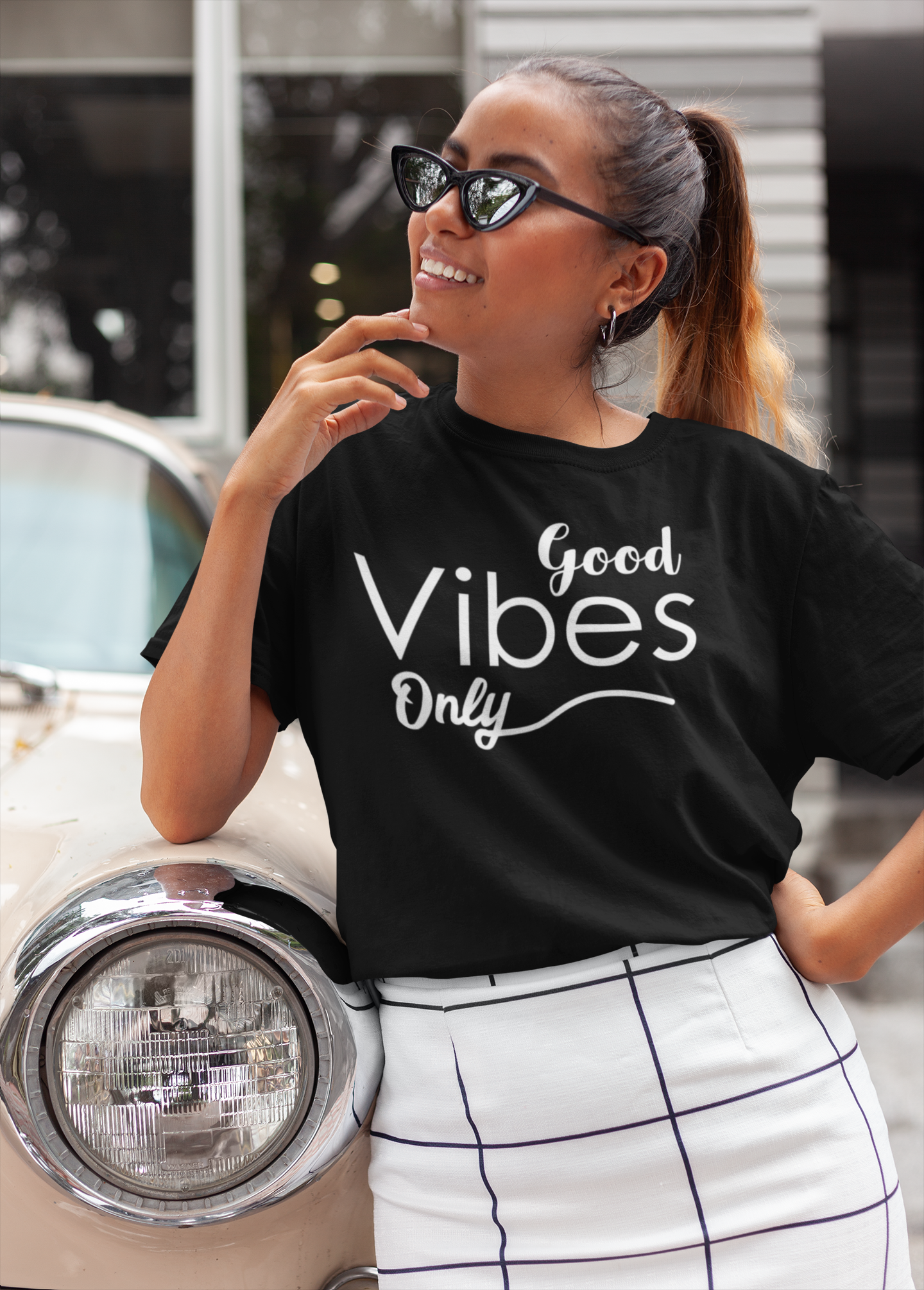 unisex-t-shirt-mockup-featuring-a-trendy-woman-leaning-on-a-classic-car-22793(3)