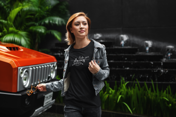 t-shirt-mockup-of-a-young-woman-walking-by-an-all-terrain-truck-412-el(1).png
