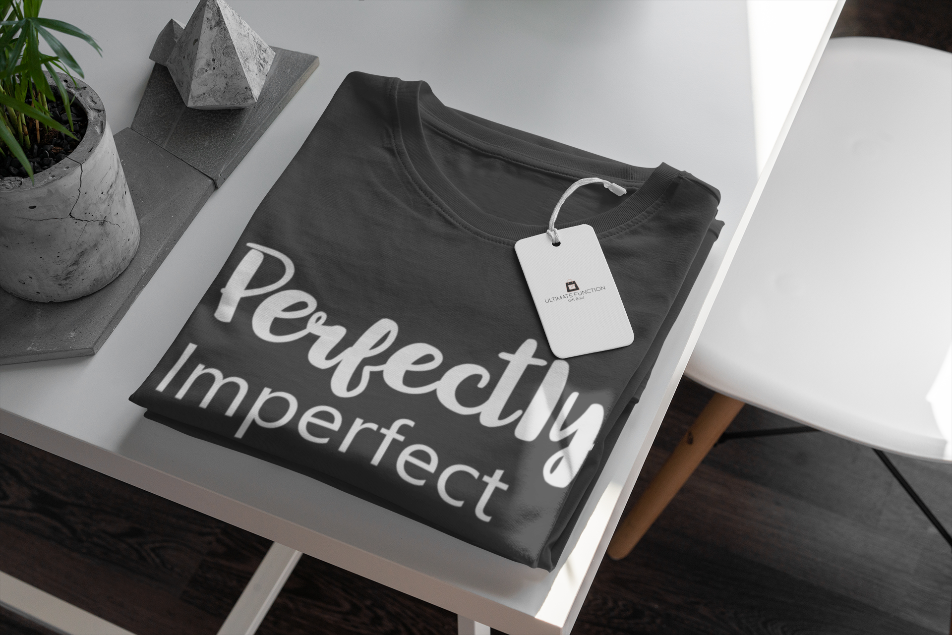 mockup-of-a-t-shirt-with-a-clothing-tag-attached-displayed-on-a-minimalistic-table-379-el
